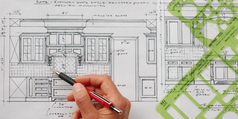 remodeling contractor planning construction project blueprints